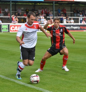 Williams featuring for Woking vs Bournemouth last Saturday