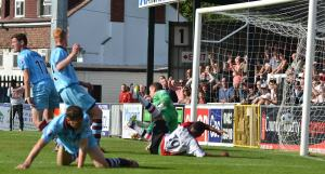 Gavin McCallum scores in Woking's 2-1 win over Gateshead last season.