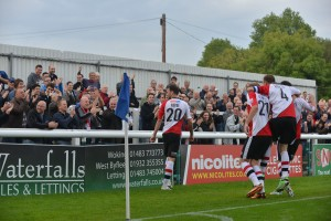 Josh Payne celebrates his goal in Woking's 2-0 win vs Nuneaton