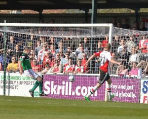 Rendell puts Woking ahead at Kingfield on Saturday.