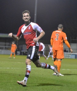 Payne celebrates his goal against Hereford United