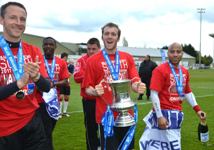 Doyle leads the celebrations as Woking win the Conference South title.