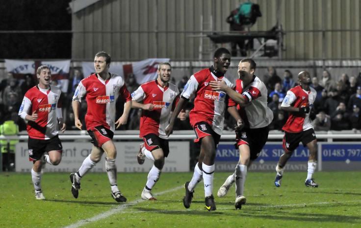 Ola puts Woking 2-1 against Brighton.