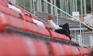 Garry Hill watches on during pre-season.