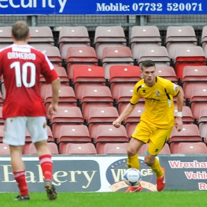 Jack Parkinson on the ball as Woking lose out to Wrexham last season