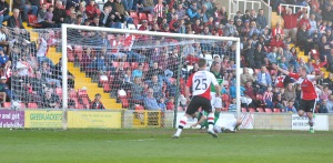 Joe Jones' header wraps up a Woking win against the Welsh side last season