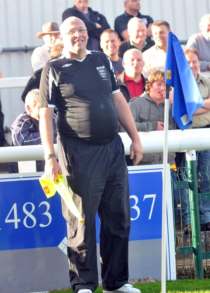 A member of the Kingfield crowd runs the line