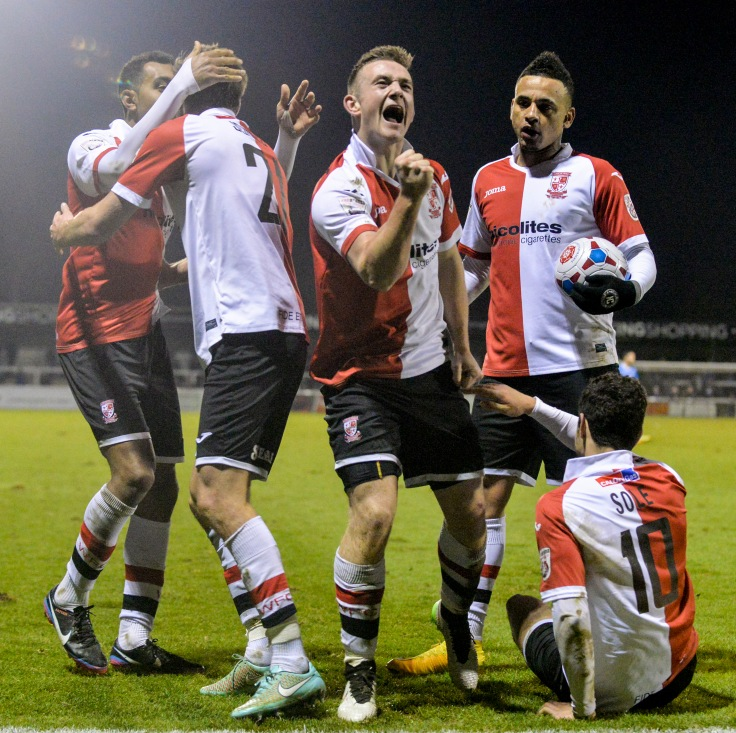 Woking celebrate Marriott's stoppage time equaliser against Eastleigh