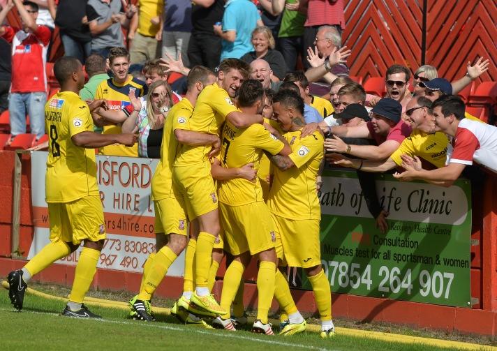 Woking celebrate beating Alfeton Town in last season's opening game