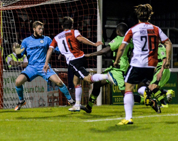 John Goddard heads Woking ahead against Forest Green Rovers